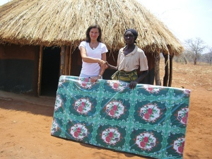 Jane Kaye-Baley of www.thebutterflytree.org.uk, donating a mattress to a widow from Mukuni Village, Zambia