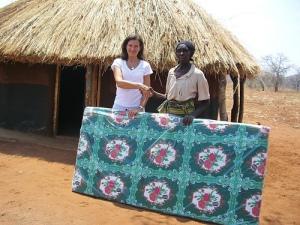 Jane Kaye-Baley of www.thebutterflytree.org.uk, donating a mattress to a widow from Mukuni Village, Zambia