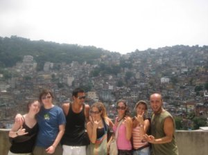 Favela tour participants with the favela in the background. Rio, Brazil