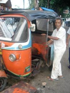 Bajaj motorized trikes ply the roads of Jakarta's slum. Photo: Jakarta Hidden Tour