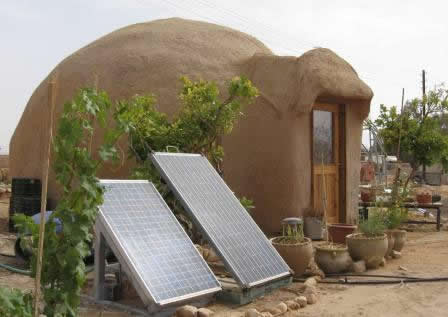 Lotan Green Apprenticeship - Incorporating alternative energy and the latest technology. Solar power at an adobe dome home.