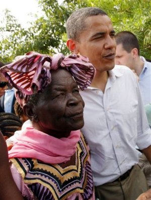 Then U.S. Senator Barack Obama, right, walks with his grandmother Sarah Hussein Obama at his father's house in Nyongoma Kogelo village, western Kenya, Aug. 26, 2006. Obama received a hero's welcome Saturday during an emotional family reunion at his late father's hometown in western Kenya. (AP Photo/Sayyid Azim)