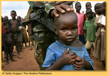 A Ugandan soldier with displaced children. More than 1.6 million villagers have fled the terror-stricken Northern countryside. Photo: www.un.org